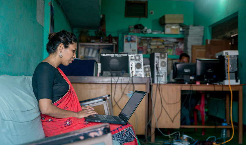 Unnati, a project participant, works in her office.