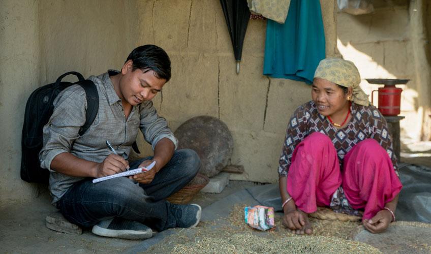 Ram Dahit interviews a community member