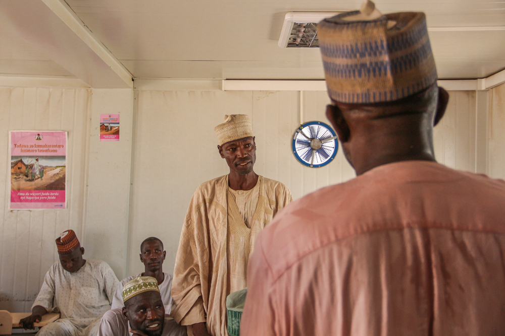 Abdullahi in a meeting with several other men